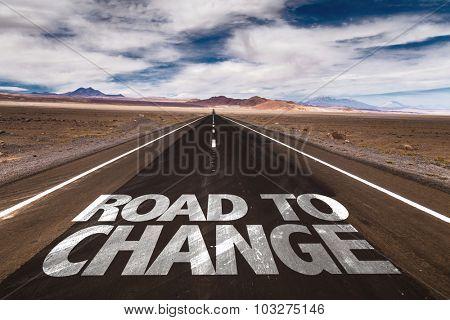 Road to Change written on desert road