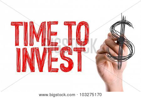Hand with marker writing: Time to Invest