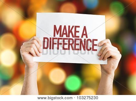 Make a Difference placard with bokeh background