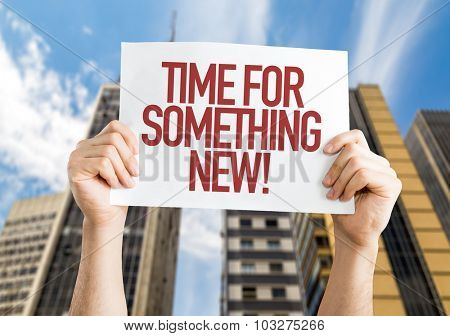 Time For Something New placard with cityscape background
