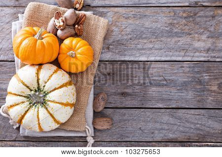 Pumpkins and nuts on the table