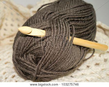 Bamboo Crochet hook in brown yarn