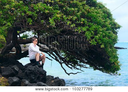 Caucasian Man In Forties On Rocky Hawaiian Shore