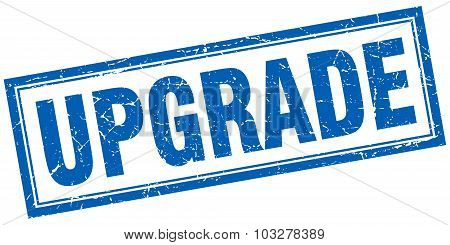 Upgrade Blue Square Grunge Stamp On White