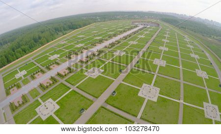 Large territory of Federal Memorial Cemetery at spring cloudy day. Aerial view video frame