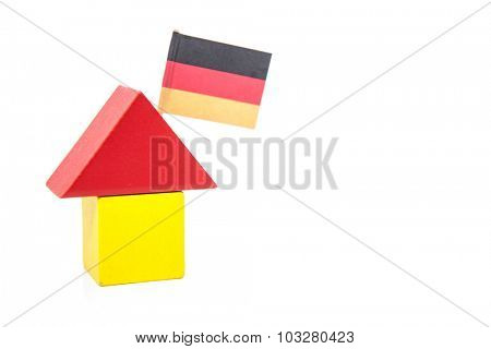 Stylized home with german flag. All on white background.