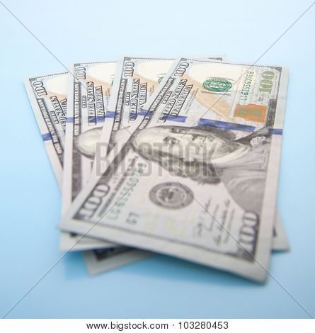 Four hundred dollar notes. All on blue background