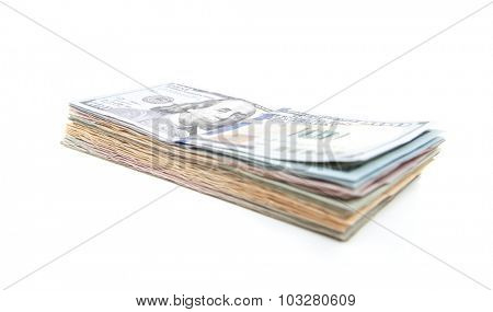 Pile of various dollar notes. All on white background