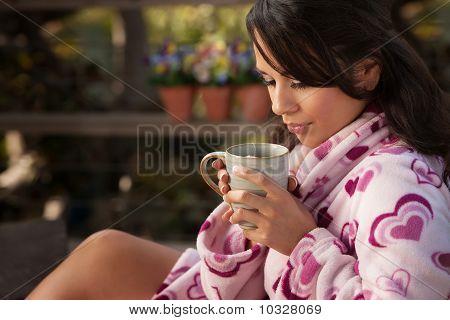 Pretty Hispanic Woman In Bathrobe With Tea