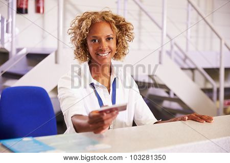 Portrait Of Staff At Airport Check In Desk