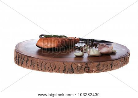 breakfast delicious portion of fresh roast salmon fillet dry spices garlic rosemary on wooden plate black forged handmade fork healthy food diet cooking concept isolated white background empty space