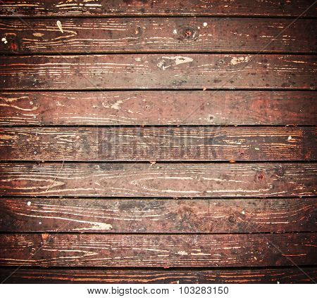 brown stained wooden floor or deck or patio with a grunge filter added for effect