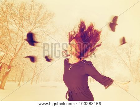 a double exposure image of a woman with birds flying around her head toned with a retro vintage instagram filter app or action effect
