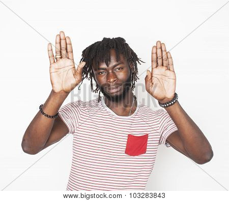 young handsome afro american guy gesturing stop both hands isolated on white background