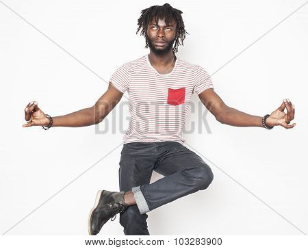 young handsome afro american guy relaxing in goofy lotos isolated on white