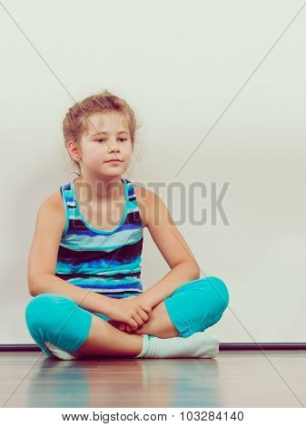 Sad Unhappy Little Girl Kid In Studio.