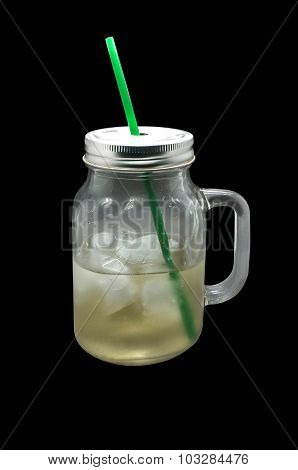 Ice beverage in glass mug with metal lid