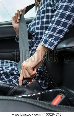 Closeup Of Woman Hand Fastening A Seat Belt In The Car