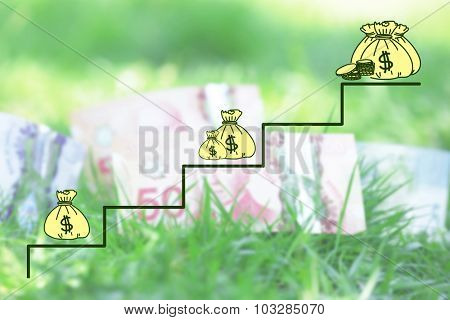Money concept. Banknotes money over green grass background