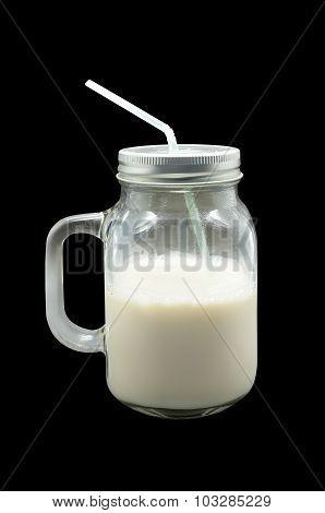 Milk in glass mug with metal lid