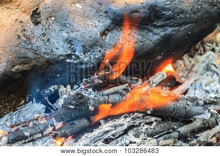 Bonfire With Orange Flames And Firewood