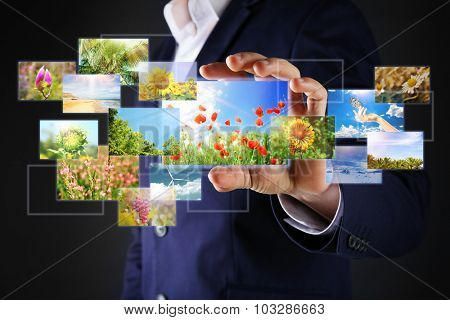 Businessman holding streaming images