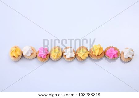 Belly button iced gem biscuits in a row