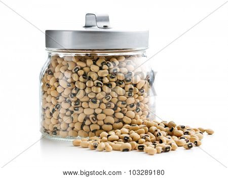 uncooked beans in jar on white background