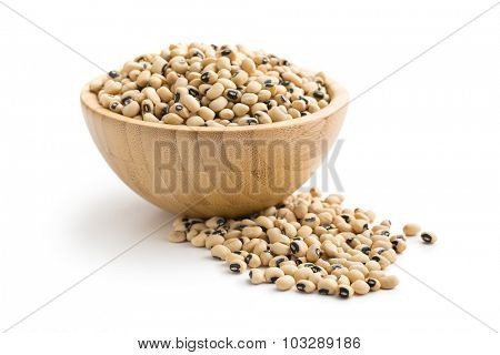 uncooked beans in wooden bowl on white background