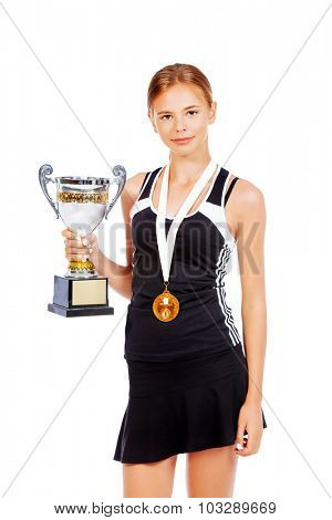 Young tennis champion posing with the cup of the winner. Isolated over white.
