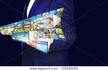 Businessman holding airplane of streaming images