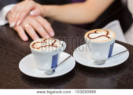 Two Cups Of Coffee And Hands
