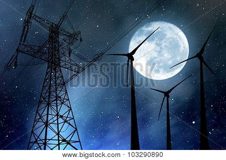Wind turbines and electricity pylon in the night sky