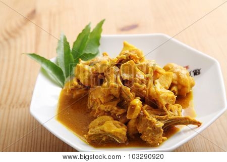 delicious turmeric chichen on the wooden table