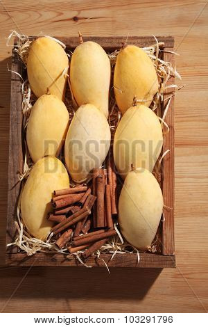 fresh mango fruit with cinnamon stick  in a wooden box