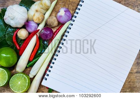 Close Up. Open Notebook With Ingredients Thai Food (tom Yum) On Wooden Background.