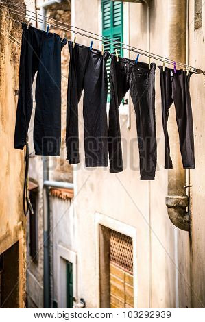 Drying Trousers In A Narrow Street