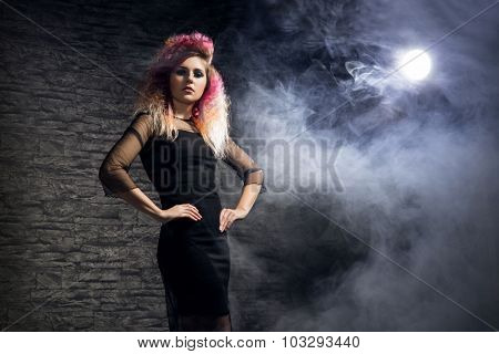 Halloween concept: young and sexy witch in the moonlight