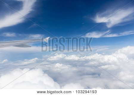 View From The Airplane Window, The Beautiful Cloudscape In Sunny Day.