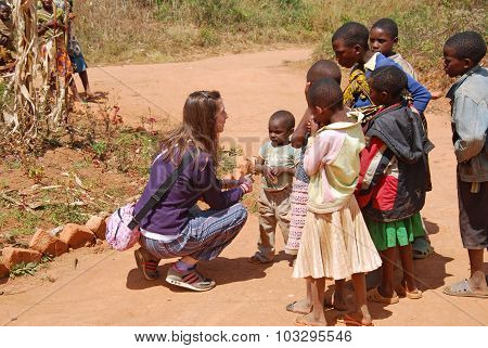 A Volunteer Female Doctor Speaks With African Children 60
