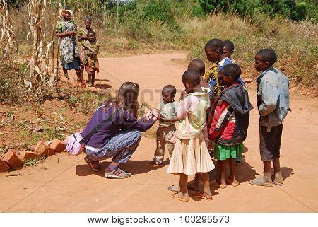 A Volunteer Female Doctor Speaks With African Children 63
