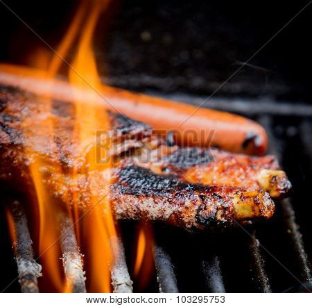Hot Dogs And Ribs On A Grill