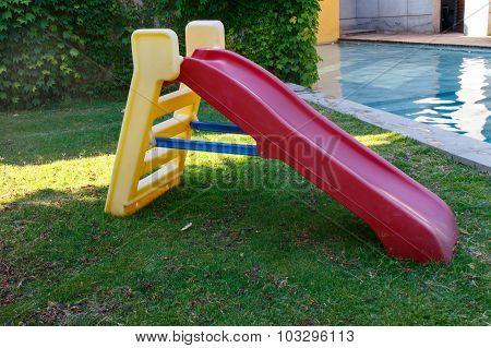 Colorful Plastic Slide In Garden