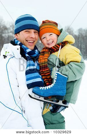 Father And Son Go Ice Skating