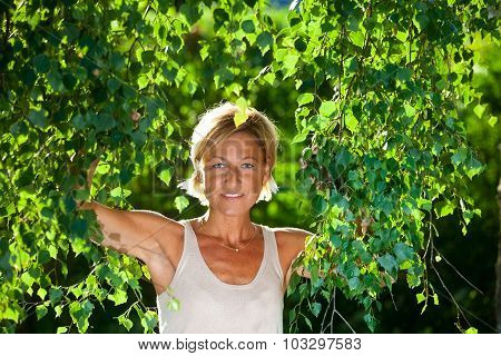 Cute Woman Portrait With Tree Branches