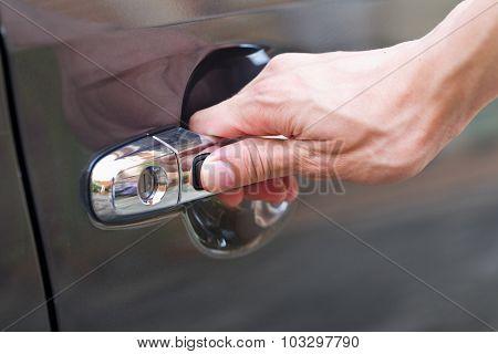 Hand Press Unlock Button Alarm System On Black Car .