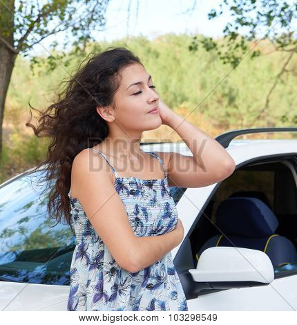 girl portrait with white car posing on road