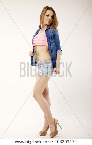 Portrait of a beautiful young adult attractive sexy and sensuality pretty brunette woman in blue jeans dress short and shirt isolated on white background