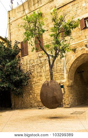 Orange Tree In Stone Vessel Levitating In The Courtyard At  Old City Jaffa . Israel