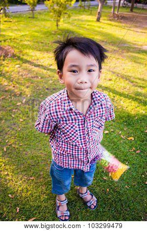 Cute Boy Fun In The Park. Sunlight In The Park